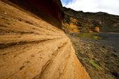 Vaggar stenen sky vatten kustlinje och sommaren i el golfo l — Stockfoto