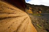 Rock stone sky water coastline and summer in el golfo l — Stock Photo
