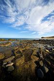 In lanzarote spain rock stone sky cloud beach — Stok fotoğraf
