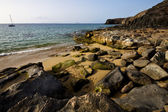 Coastline rock waand summer in lanzarote spain — Stockfoto