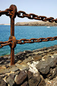 Rusty chain water boat and sr in lanzarote spain — Photo