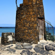 Tower spain  hill yellow  beach    black rocks   lanzarote — Stok fotoğraf