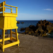 Yellow lifeguard chair cabin  in spain  lanzarote  rock stone sk — Stock Photo