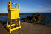Yellow lifeguard chair cabin in spain lanzarote rock stone sk — Foto de Stock