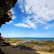 In lanzarote   spain  rock stone sky cloud beach — Stok fotoğraf