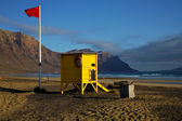 Lifeguard chair red flag in spain pond coastline and summer — Stock Photo