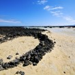 People spain  hill white  beach  spiral of black rocks     lanza — ストック写真