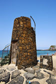 Tower yellow beach black rocks in the lanzarote — Stock Photo