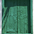 Spain green wood   window in a white wall arrecife   — Stock Photo
