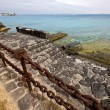 Pier rusty chain  water  boat yacht coastline and summer  lanzar — ストック写真