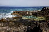 Coastline in lanzarote sky cloud beach water musk and summe — Stock Photo