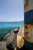Latarnia morska i łodzi w arrecife niebieski teguise — Zdjęcie stockowe