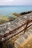 Pier rusty chain water in lanzarote spain — Stock Photo
