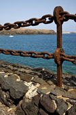 Rusty chain water boat and summer in lanzarote spain — Stock Photo