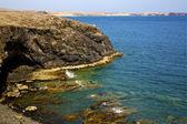 Volcanic spain water coastline in lanzarote sky cloud beach — Stock Photo