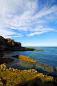 Beach light water lanzarote foam rock landscape sky clo — Stock Photo