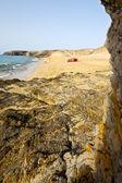 People tent salt sky light beach water in lanzarote isle foa — Stockfoto