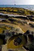 Boat lanzarote coastline rock beach and summer — Stock Photo