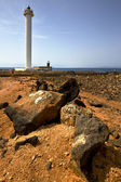 Lighthouse and rock in the anzarote spain — Stock Photo