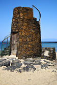 Tower spain hill yellow beach black lanzarote — Stock Photo