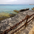 Pier rusty chain  water  boat yacht coastline and summer  lanzar — Stock Photo