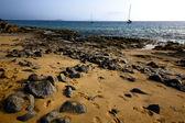 Coastline rock beach water boat yacht and summer — Stock Photo