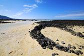 People spain hill white beach spiral of black rocks in lan — Stock Photo