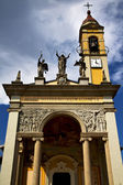 in cairate varese italy  church watch bell clock tower   — Stock Photo