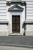 Old castronno   in  italy   the old  wall  and church door   — Foto Stock