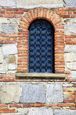 Besnate cross church    and mosaic wall  sunny day — Stok fotoğraf
