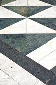 Busto arsizio  street lombardy   abstract   pavement curch — Stock Photo