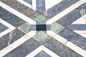 Busto arsizio y pavement of a curch and marble — Stock Photo