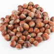 Stock Photo: Nuts on the white background