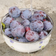 Washing plums — Stock Photo