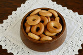 Russian bread ring in wooden bowl — Stock Photo