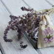 Lavender aroma bag on wooden background — Stock Photo