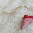 Red heart on Russian downy shawl — Stock Photo