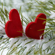 Stock Photo: Two red hearts in pine needles covered with snow