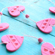 Stock Photo: Bunch of pink decorative hearts on shabby blue background