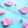 Bunch of pink decorative hearts on shabby blue background — Stock Photo