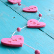 Pink decorative hearts on blue shabby background — Stock Photo