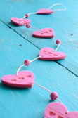 Pink decorative hearts on blue shabby background — Stock Photo