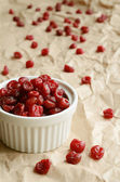 Dried sweet cherries in white ramekin — Stock Photo