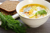 Bowl of homemade fish soup served with dark bread and dill — Foto Stock