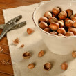 Cracking hazelnuts — Stock Photo