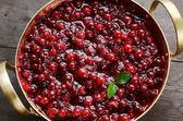 Homemade cranberry jam in brass bowl — Stock Photo