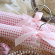 Photo: Decoration with clothing hangers on crocheted background in vint