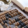 Still life with vintage wooden abacus — Stock Photo