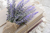 Bunch of lavender placed on book bundle — Stock Photo