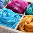 Set of colorful scarfs in wooden box — Stock Photo